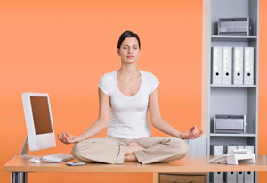 20100514-woman-meditating-work-300x205