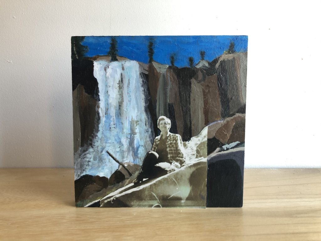 small painted canvas of a waterfall and rocks with a black and white photo of a woman glued to it,