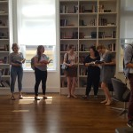 The Innovation Hub team reads books in the Monk School library