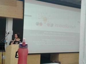 Julia Smeed talking at podium