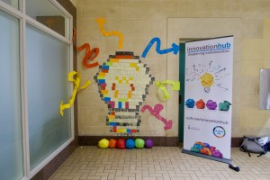 Wall art installation of lightbulb made of colourful sticky notes