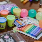 Crafts supplies including Play-Doh and pastels