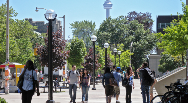 Students walk along St. George Street in the summer.