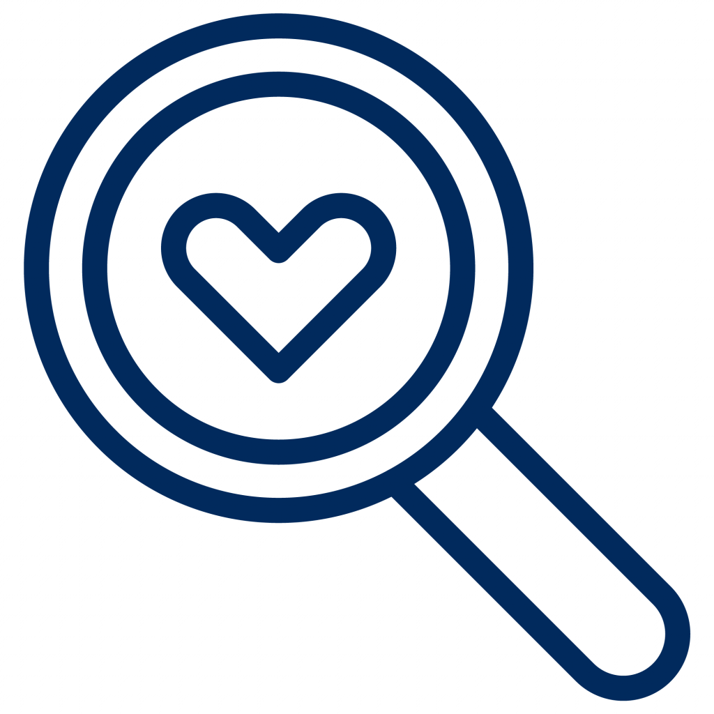 A magnifying glass looking into a heart
