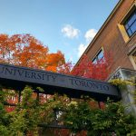 An arch that reads The University of Toronto, on a bright and sunny day.