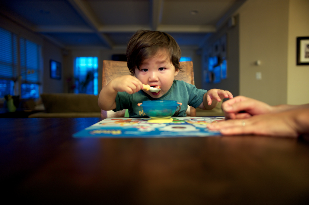 Baby Eating Cereal By BobbyBokeh