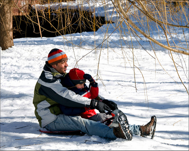 Father and son tobogganing