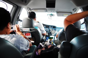 Interior shot of family driving in minivan full of activities and luggage.