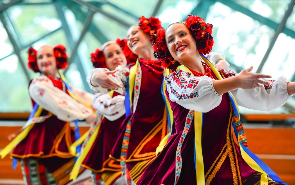 Image of four female dancers in traditional Ukrainian dance outfits