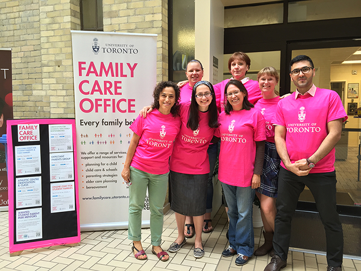 Image of six of this year's peer mentors in pink UofT t shirts outside of the FCO door.