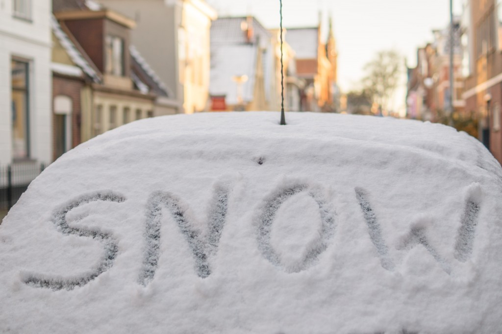Image of snow-covered car window with 'Snow' written on it