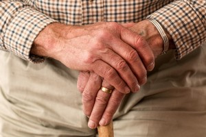 Close up crossed hands of an elderly man