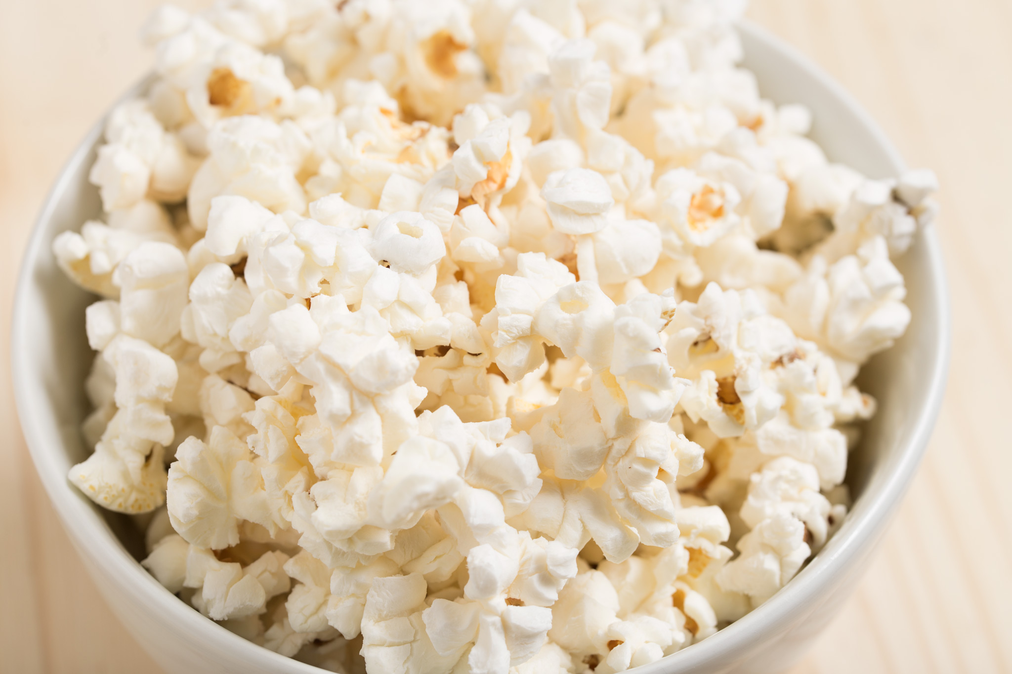 Bowl of unbuttered popped popcorn kernels