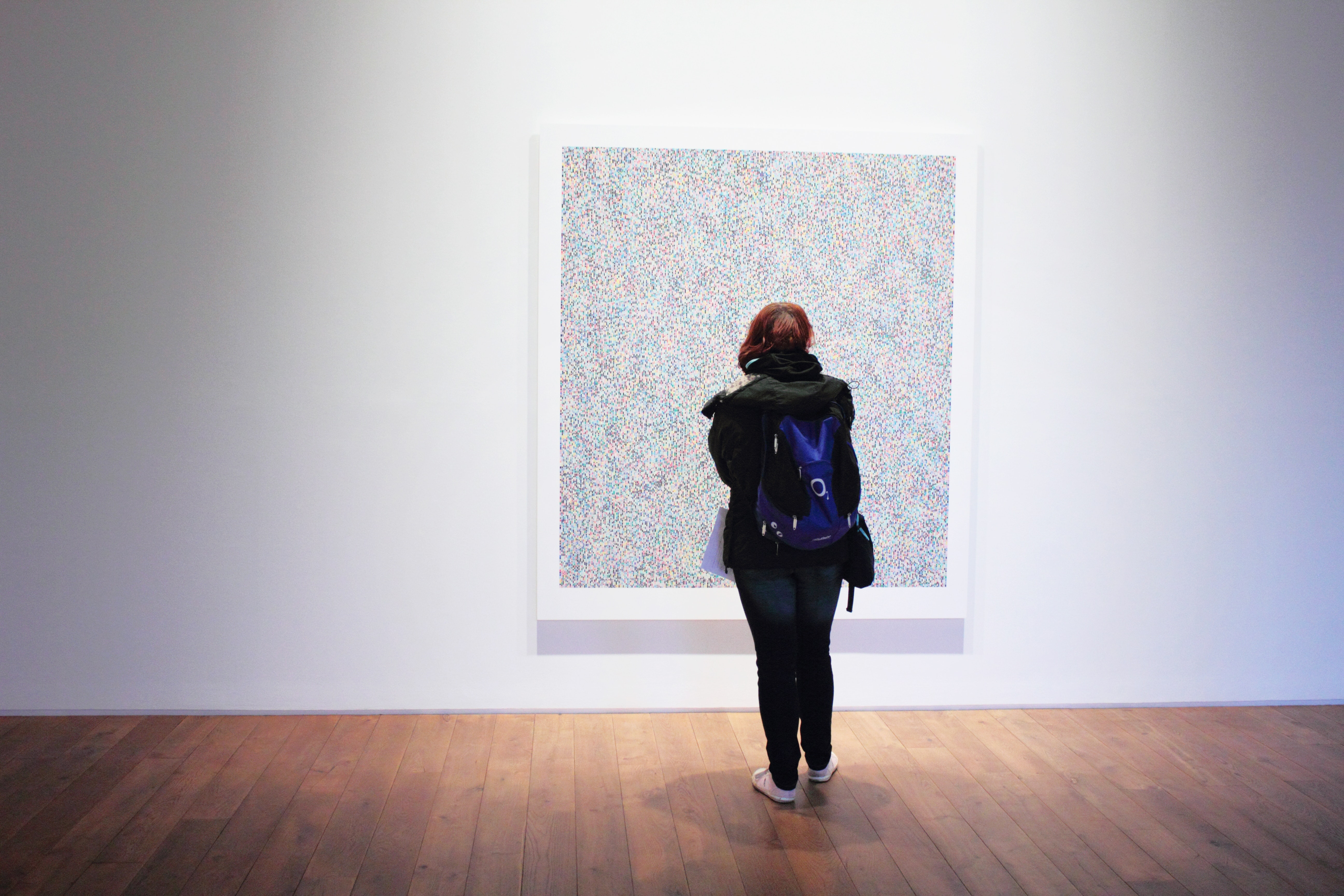 girl looking at art
