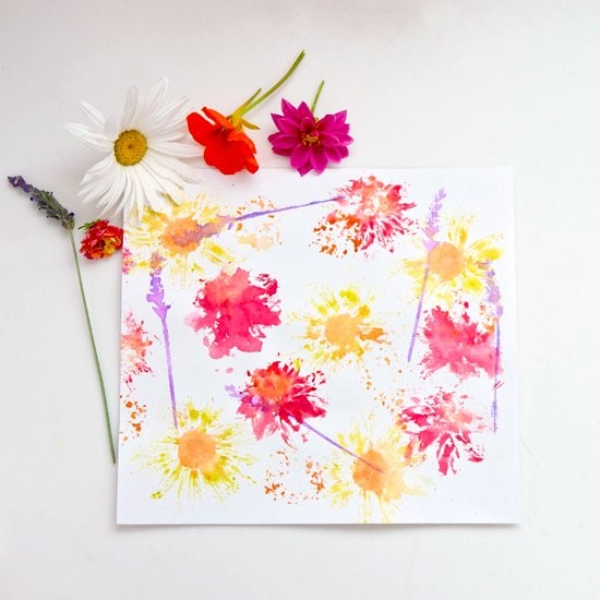 Flowers, yellow and pink paint prints on white paper.