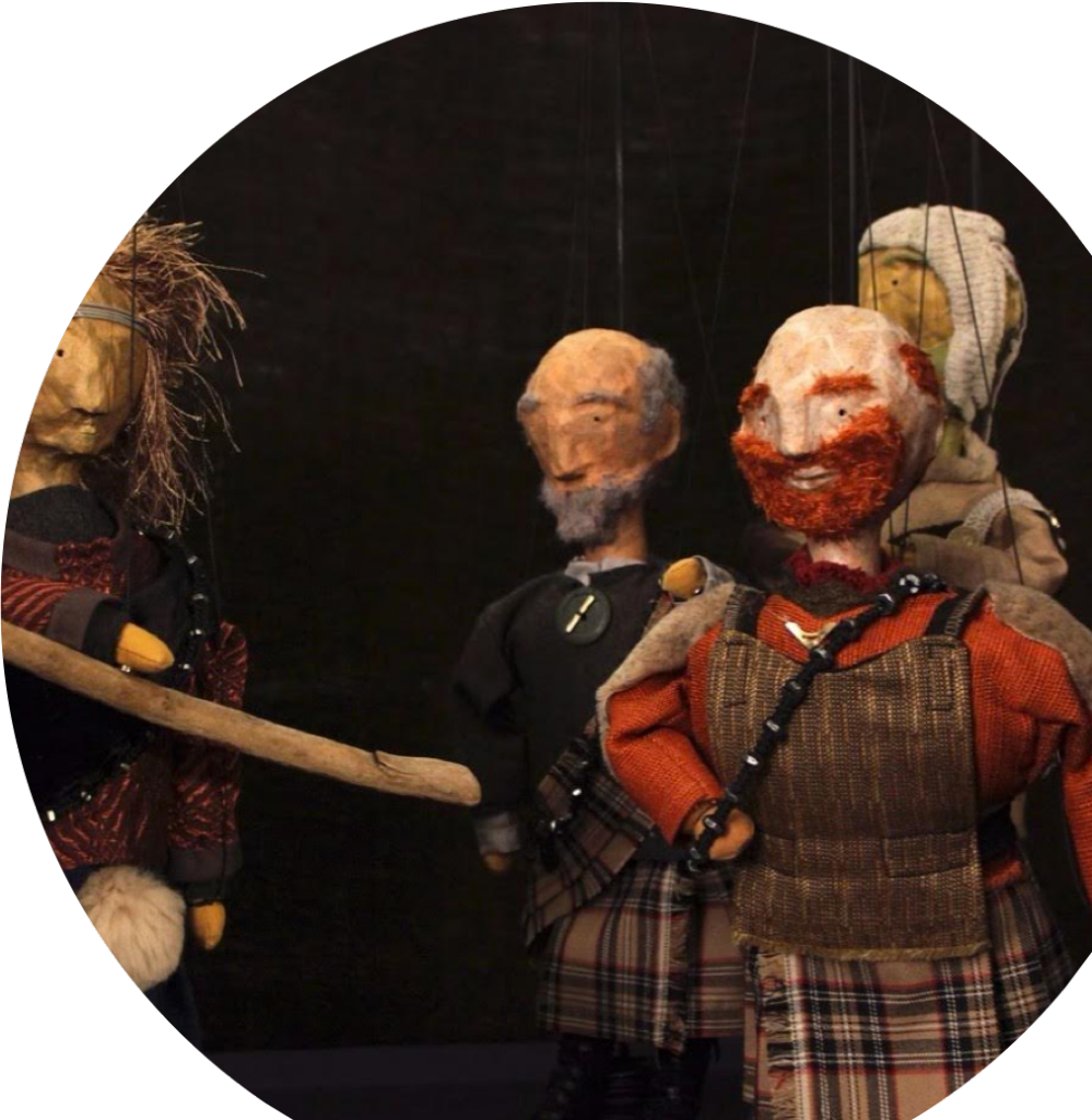 Puppets hanging from ceiling.