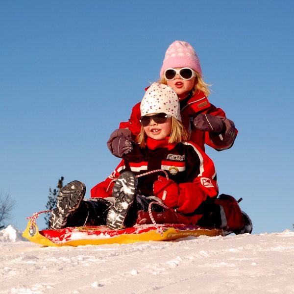Girls on a sled