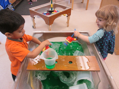 Girl and Boy at Water Table