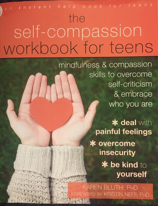 The self-compassion workbook for teens with a front desk cover.