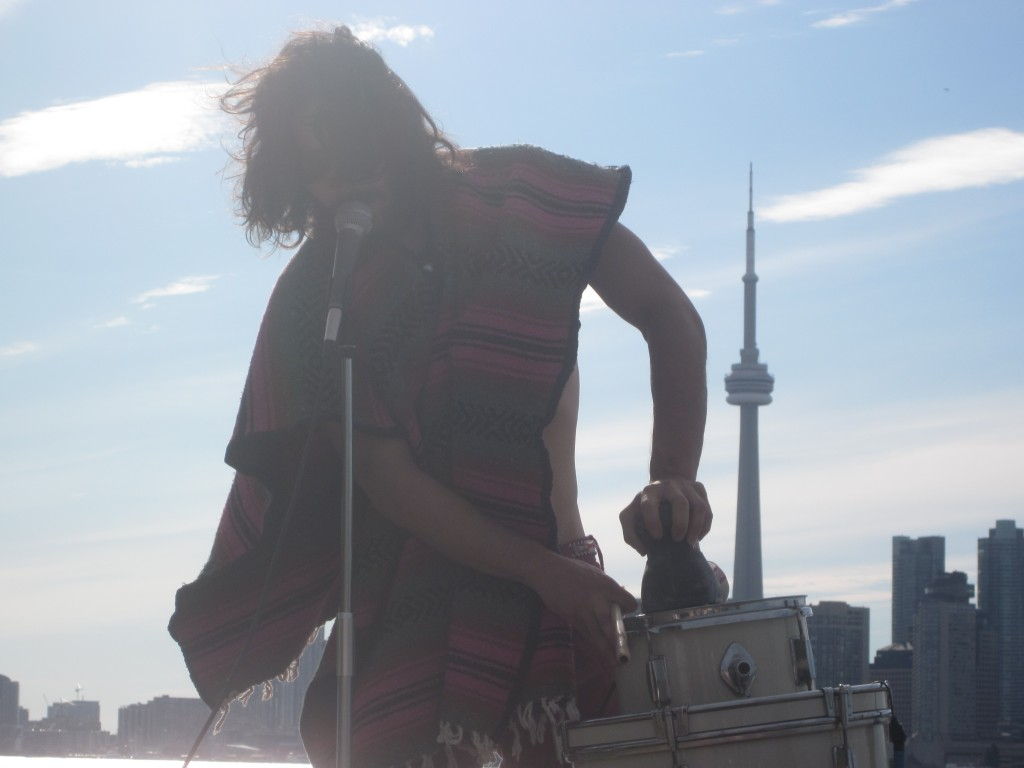 This is local musician Man Made Hill, one of the 100 artists I saw, playing on Toronto Island. That's a sander on a drum.