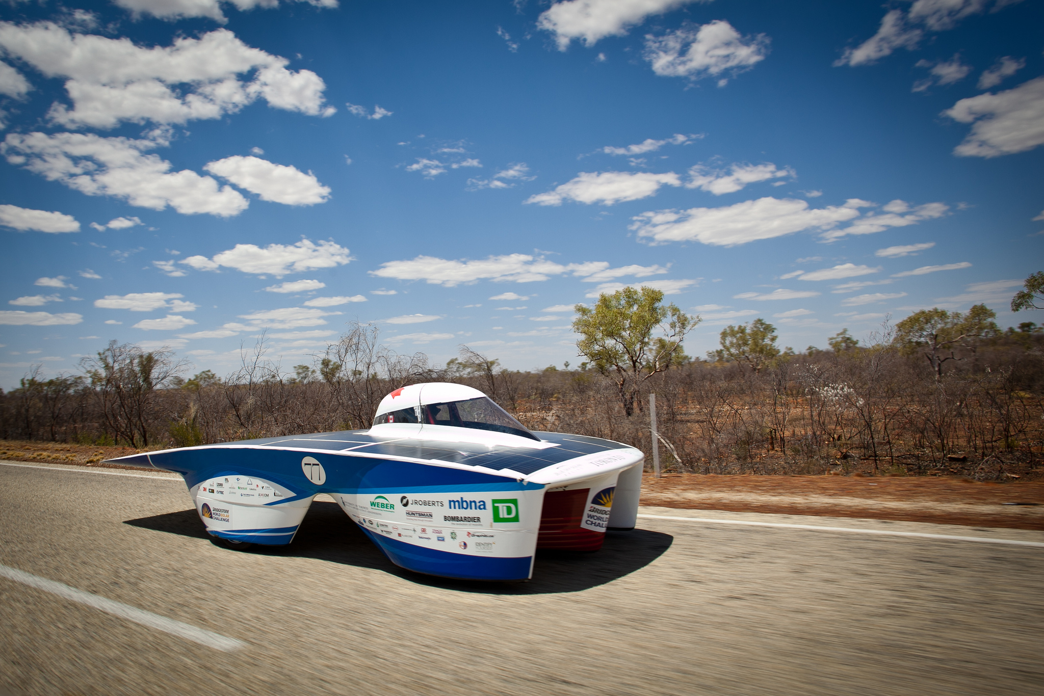 The B7 car competing in the 2013 World Solar Challenge. (via flickr.com/photos/blueskysolar)
