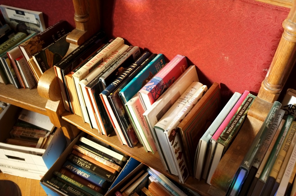 sunlight on books stacked in a pew in the chapel