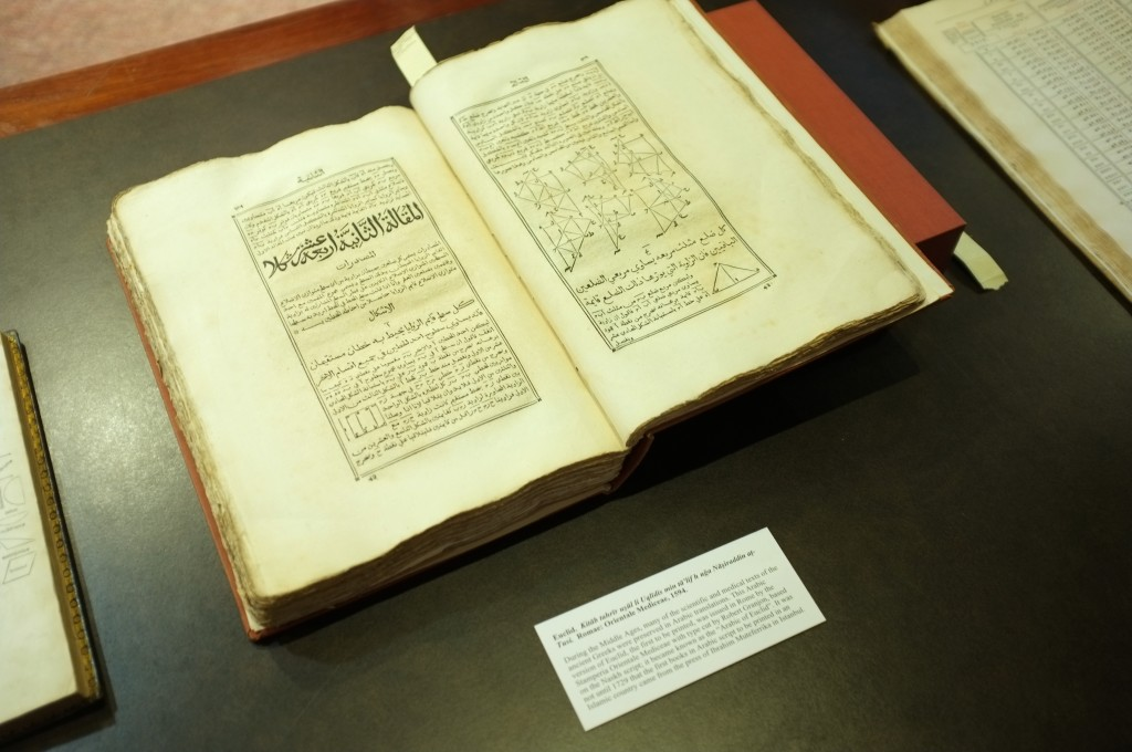 a shot showing a book by Euclid that has been translated from Greek to Arabic. The book is from 1594 and was printed in Rome.