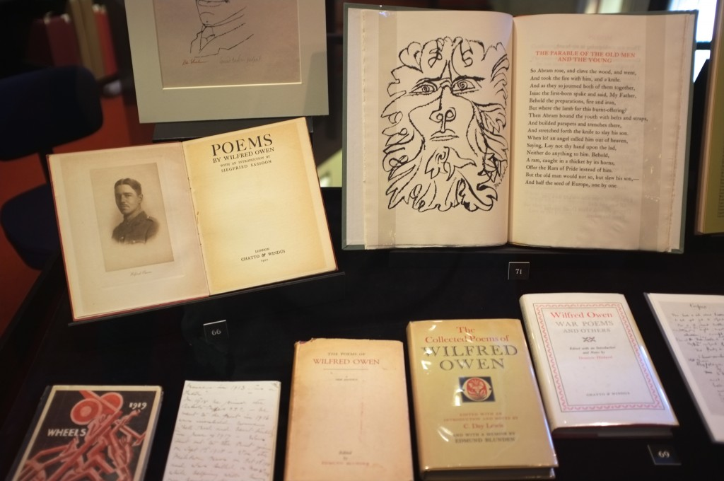 several books of the poems of Wilfrid Owen are displayed. One is open to show a picture of him while another shoes a strange line drawing that kind of looks like a lion and a person at the same time.