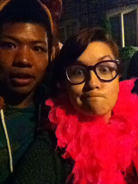 Me and Haley taking a selfie. I'm wearing a cow hat, and Haley is wearing an outrageously pink feather boa. We both look confused.