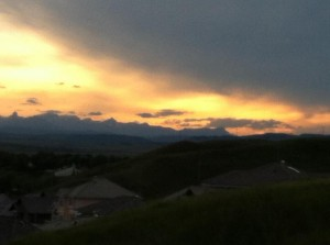 In the evening, looking West at the vast Rocky Mountains over my sleepy little foothills town, with the twilight sun still gleaming from behind the mountains.