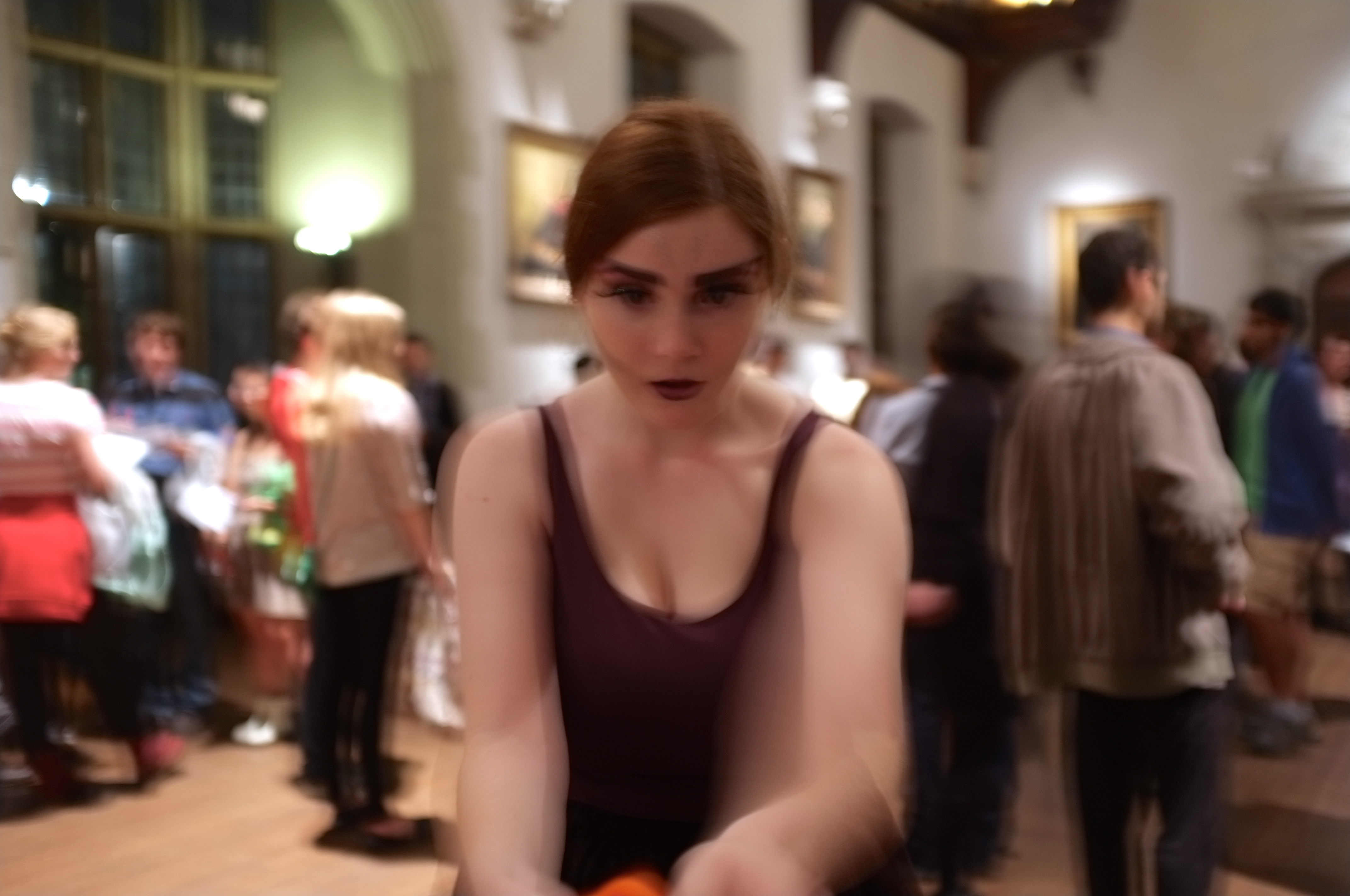a girl dressed as a fairy looking confused into middle distance below the camera. Slightly blurry and out of focus because she is moving.