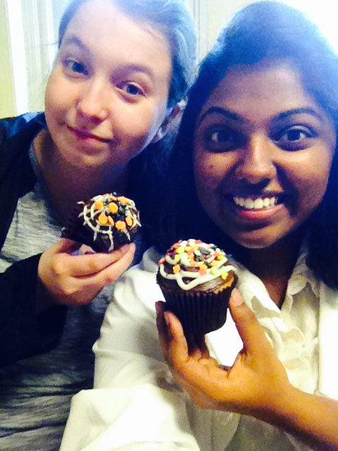 photo of Amie and Api holding cupcakes