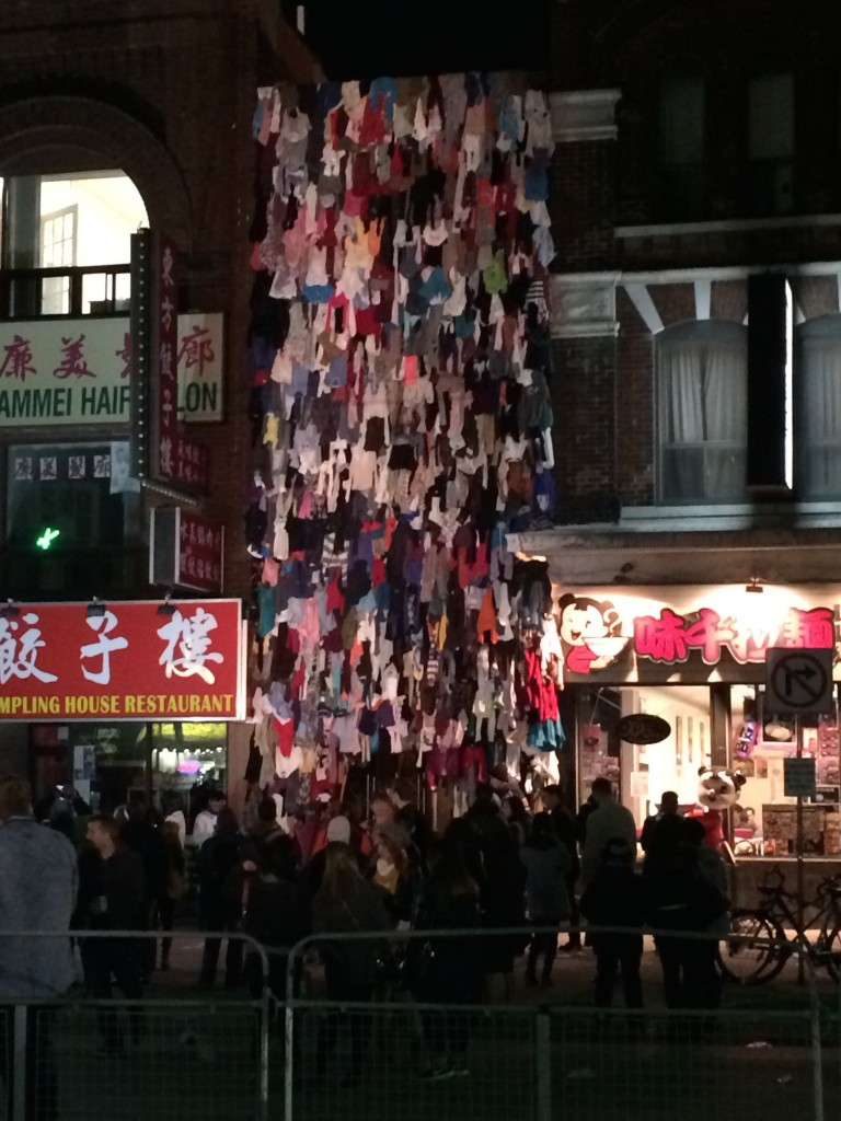 A storefront covered in clothes, from top to bottom. All clothes.