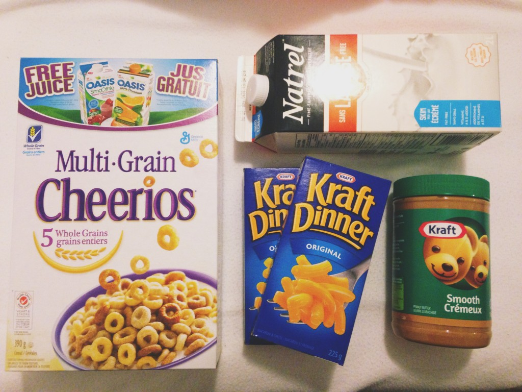 Photo of Groceries including Multigrain Cheerios, Kraft Dinner, Peanut Butter and a carton of Milk