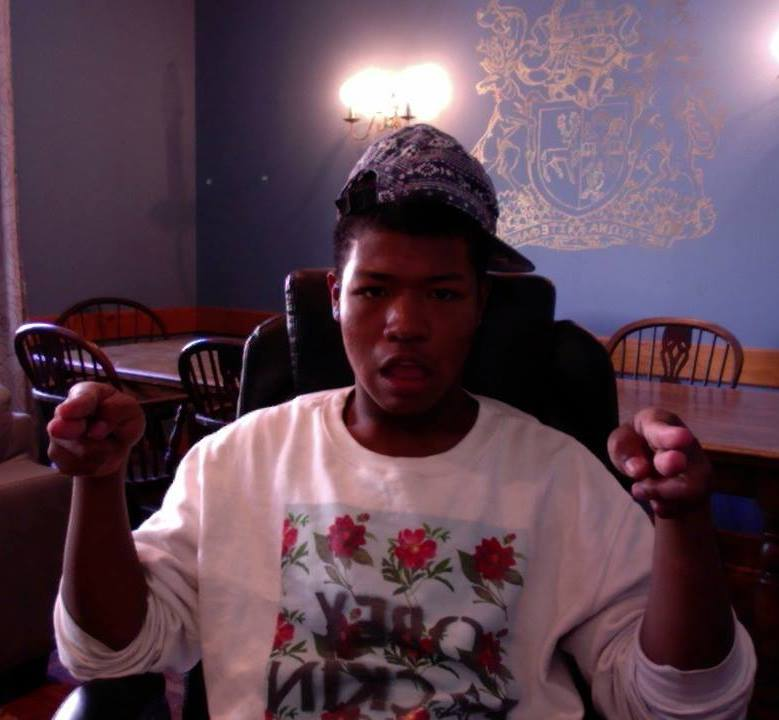 A picture of me wearing a cap backwards, and pointing at the webcam.