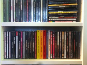 Two shelves full of CD cases, with everything from Jeff Beck to Van Halen, in alphabetical order of course.