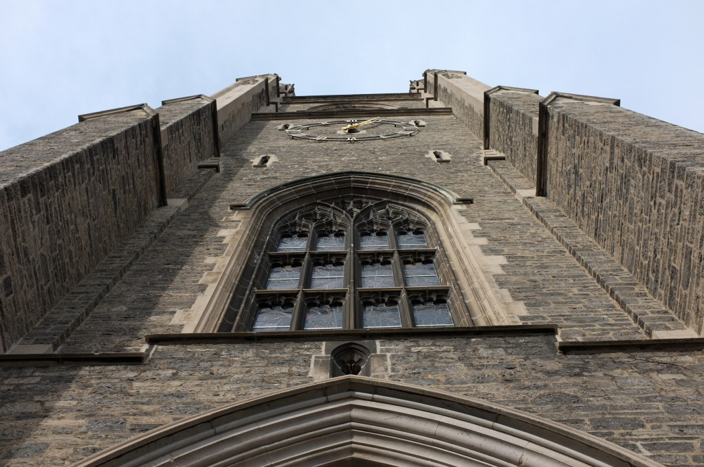 view standing almost beneath the soldiers tower looking straight up at the arch, window, and clock.