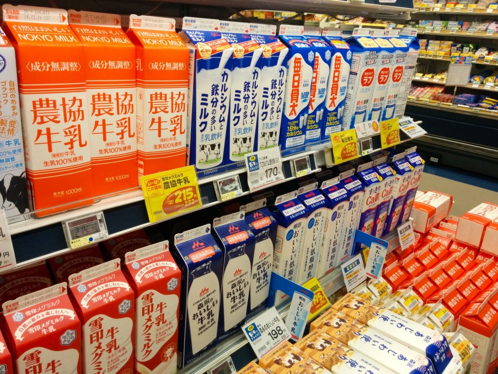 This image shows collection of milk cartons at a grocery store.