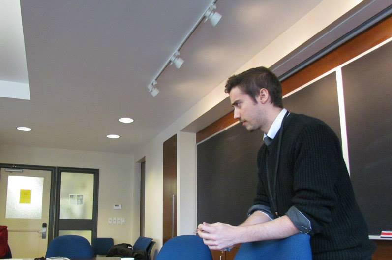 Photo of Charles presenting a paper at the Women in Philosophy conference. This is like, the only half decent photo of him out of ten.