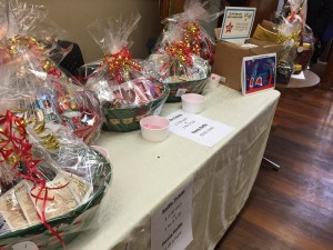 A table with huge baskets of colourful candies and crafts, which were the prizes for the raffle