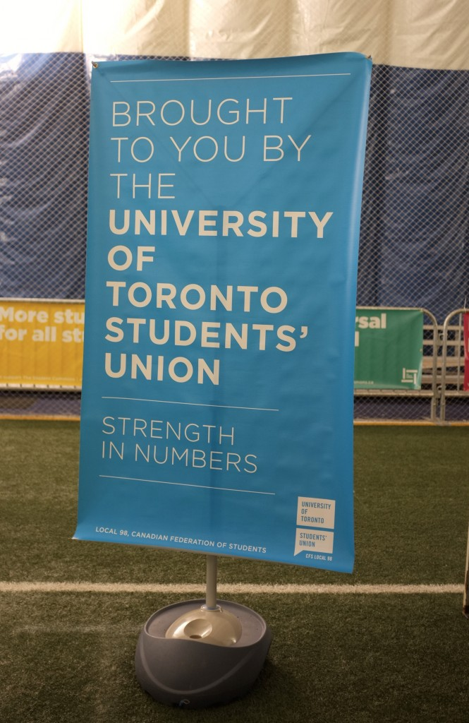 "a blue banner that says ""brought to you by the universiy of toronto Students' union"""