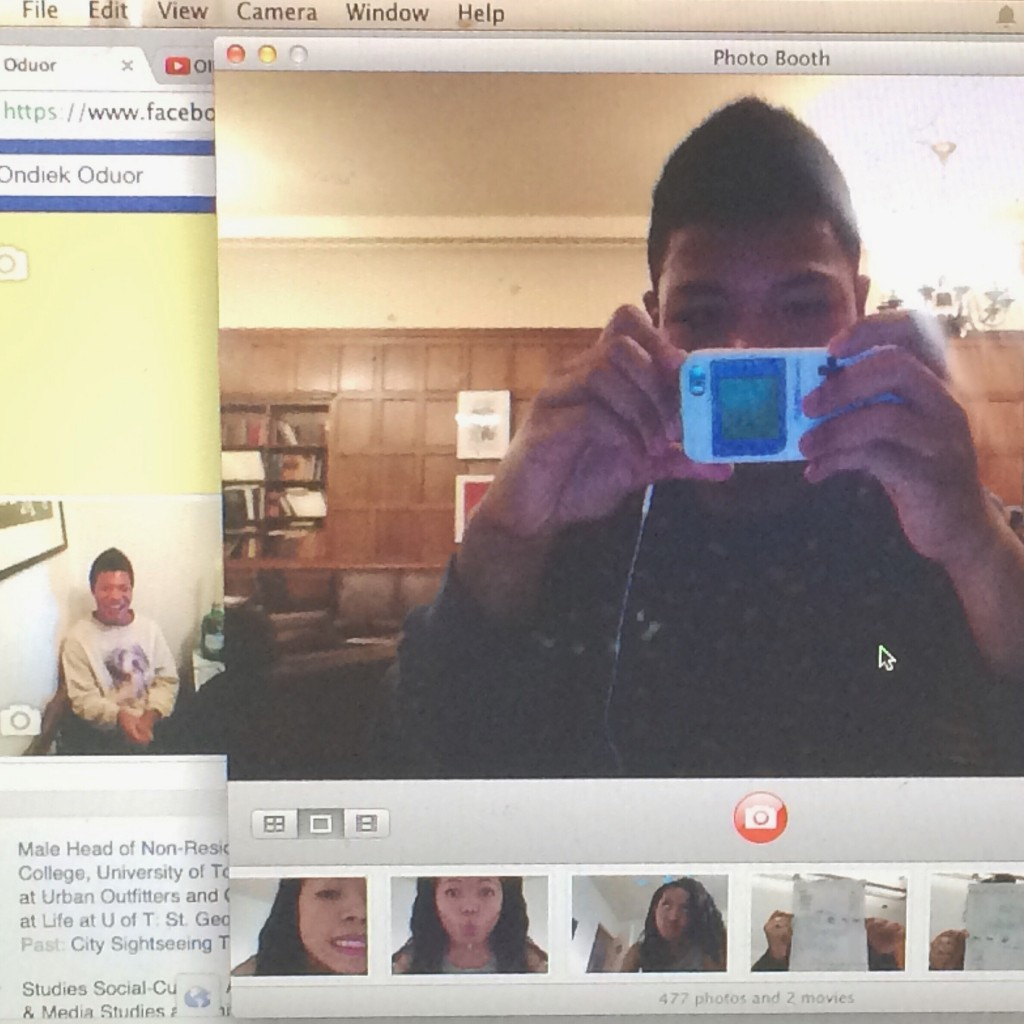 Me taking a picture with my iPhone of my MacBook which has Photo Booth on.  A meta-selfie?