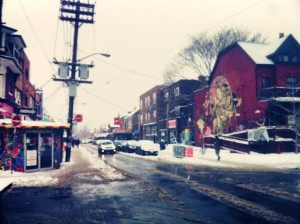 A wet snowy day, looking down one of the colourful crazy streets of Kensington Market