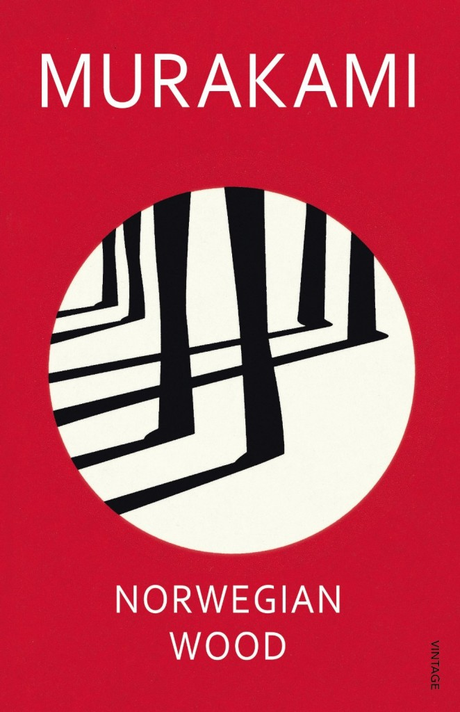 "This image shows the front cover of Haruki Murakami's ""Norwegian Wood."" It is red featuring a white circle in its centre. Dark tree trunks cast shadows inside the circle."