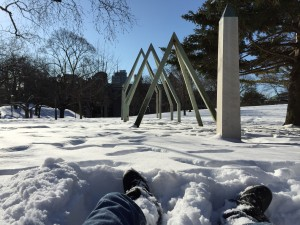 from my perspective while lying in the snow, looking at the obelisk frames in the grass plot in front of Hart House