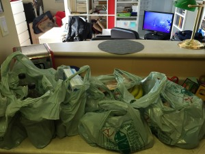 eight or nine bags of groceries on my kitchen counter