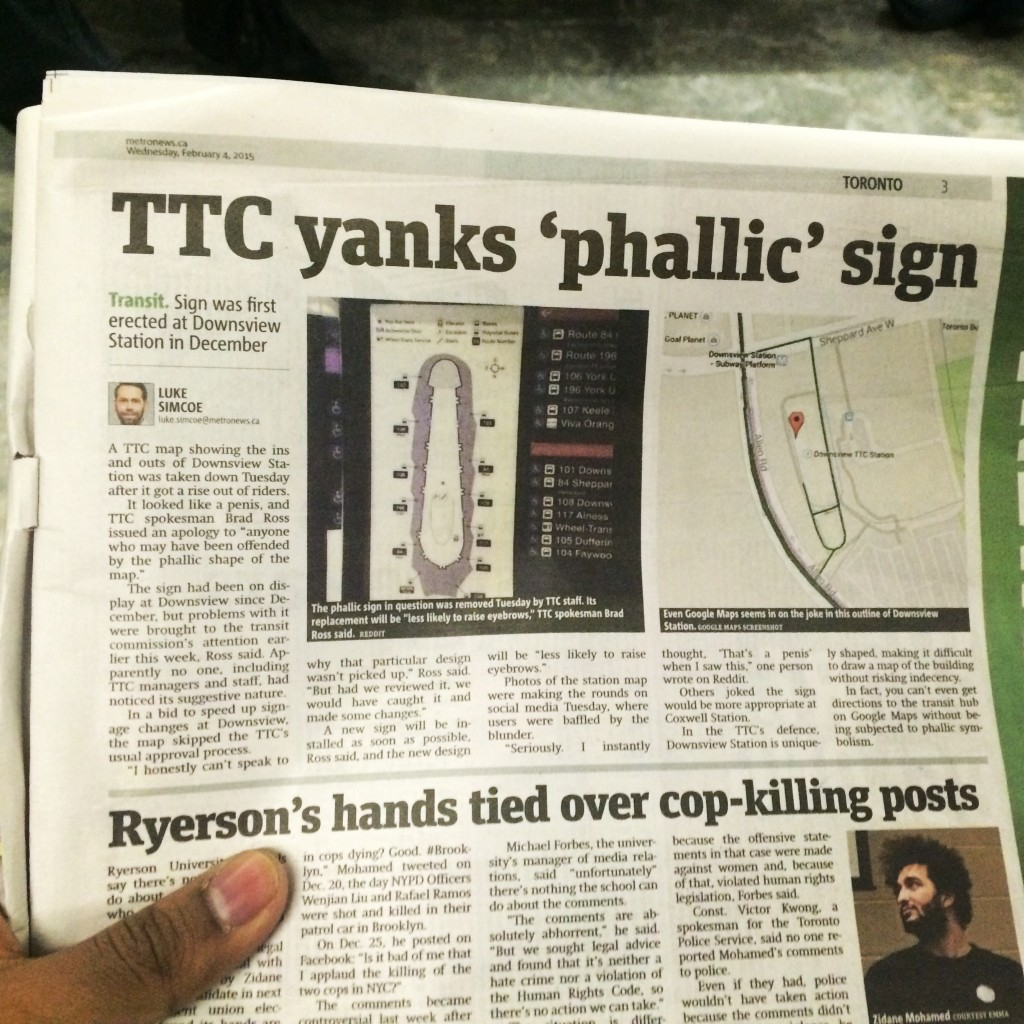 """A picture of a Metro newspaper article. The title is """"TTC yanks 'phallic' sign."""" You can imagine how funny this is. They made a map that looks like a phallus by mistake."""