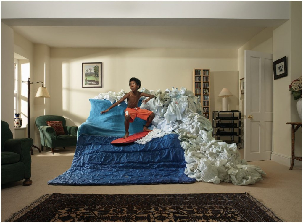 photo of child on a surfboard on a couch. A little too literal if you ask me.