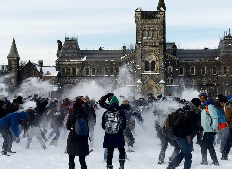 picture of students throwing snow with University College in the Background