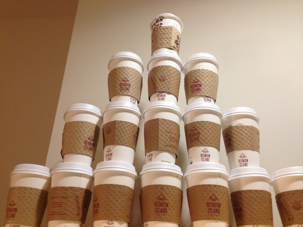 Photo of: a tower of coffee cups stacked high